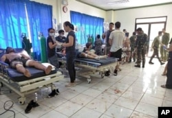 Bomb victims receive treatment in a hospital after two bombs exploded outside a Roman Catholic cathedral in Jolo, the capital of Sulu province in southern Philippines, Jan. 27, 2019, in this photo provided by WESMINCOM Armed Forces of the Philippines.