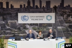 U.N. Climate chief Patricia Espinosa (C) is flanked by officials during a press conference at the COP24 climate change summit in Katowice, Poland, Dec. 2, 2018.