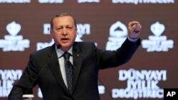 Turkey's President Recep Tayyip Erdogan talks during a rally in Istanbul, March 12, 2017.