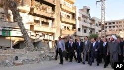 بشار اسد و برخی مسئولان پس از نماز عید قربان در داریا در حومه دمشق- خبرگزاری رسمی سانا