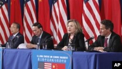 From left, Chinese State Councilor Dai Bingguo, China's Vice Premier Wang Qishan, Secretary of State Hillary Rodham Clinton, and Treasury Secretary Timothy Geithner take part in a joint meeting of the US-China Strategic and Economic Dialogue, May 10, 201