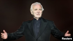 FILE - French singer Charles Aznavour performs during the Quebec Summer Festival, July 6, 2008.