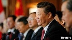 Chủ tịch Trung Quốc Tập Cận Bình sẵn sàng sử dụng sức mạnh gia tăng của Bắc Kinh, theo ông Rachman. Jan. 16, 2017