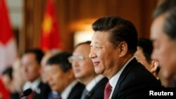 FILE - China's President Xi Jinping attends official talks in Bern, Switzerland.