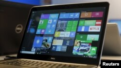FILE - A laptop computer featuring Windows 10 is seen on display at Microsoft Build in San Francisco, April 29, 2015.