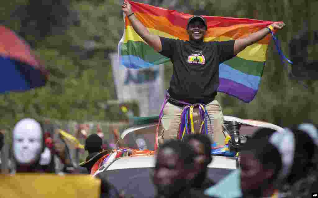 Ugandans take part in the 3rd Annual Lesbian, Gay, Bisexual and Transgender (LGBT) Pride celebrations in Entebbe, Aug. 9, 2014.