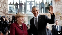 Presiden Obama (kiri) bersama Kanselir Jerman, Angela Merkel di Berlin, Jerman, 18 November 2016 (AP Photo/Markus Schreiber).