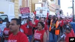 FILE - Union members picket outside the Trump Taj Mahal caino in Atlantic City, N.J.