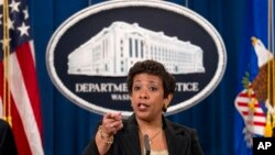 Attorney General Loretta Lynch speaks during a news conference at the Justice Department in Washington, Thursday, Dec. 3, 2015, to discuss the FIFA corruption case.