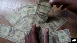 Zimbabwe uses the United States dollar and other currencies.