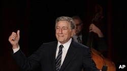 "Tony Bennett gestures after singing ""I Left My Heart in San Francisco"" during a sound check for a Valentine's Day benefit concert in the Venetian Room at the Fairmont Hotel in San Francisco. Bennett returned the hotel to celebrate the 50th anniversary of"