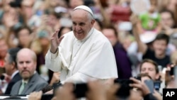 FILE - Pope Francis established a commission to study economic reform at the Vatican. Two of its members have been arrested, suspected of theft and leaks, the Vatican said.