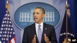 Başkan Obama Beyaz Saray'da açıklama yaparken