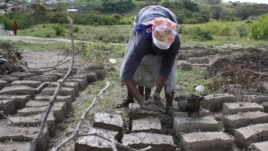 When the government failed to build a clinic at Masizini, local women built the health point out of mud (D. Taylor/VOA)