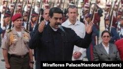 Venezuela's President Nicolas Maduro (C) speaks after his arrival at the Simon Bolivar airport in La Guaira, Venezuela, Oct. 7, 2017.