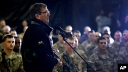 Defense Secretary Ashton Carter speaks with U.S. military personnel at Kandahar Airfield in Afghanistan, Feb. 22, 2015.