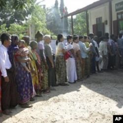 Voters line up at a polling station to cast ballots in Bago, about 90 km northeast of Rangoon.