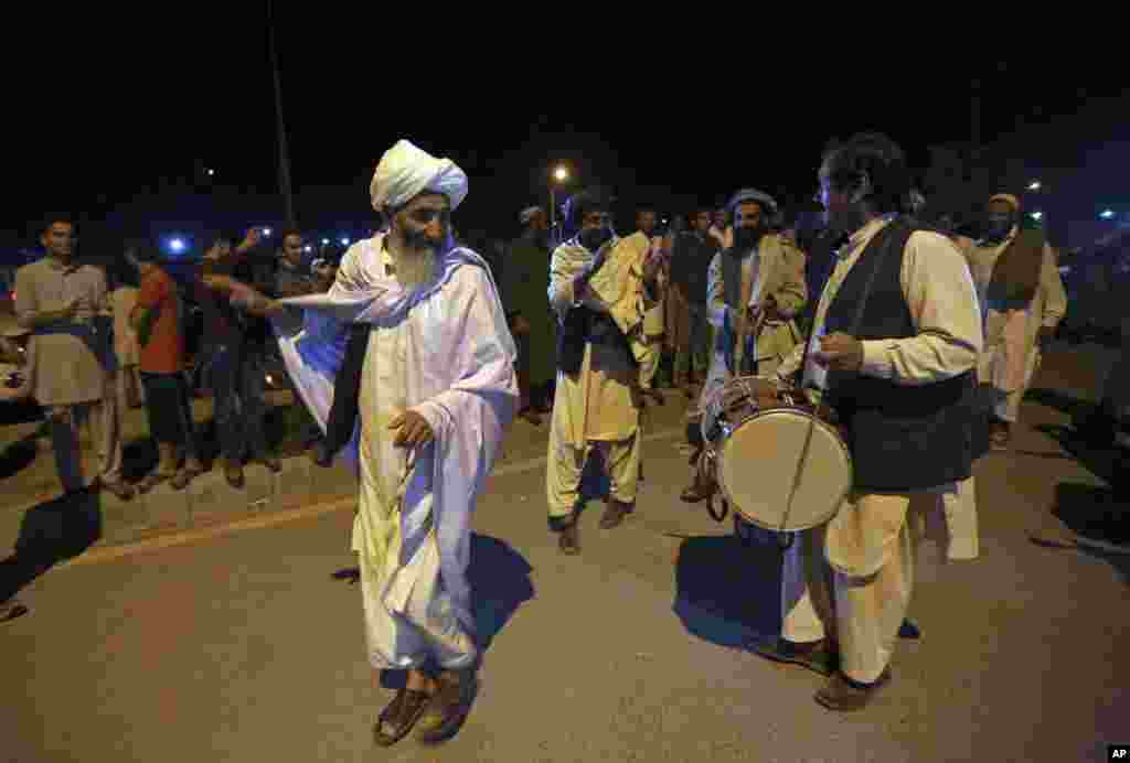 Supporters of Ashraf Ghani Ahmadzai celebrate with music and dancing near his residence after he was named the winner and next president by the Afghan election commission, in Kabul, Afghanistan, Sept. 21, 2014.