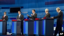 Republican presidential candidates, from left to right: Texas Gov. Rick Perry; former Pennsylvania Sen. Rick Santorum; former Massachusetts Gov. Mitt Romney; former House Speaker Newt Gingrich; and Rep. Ron Paul, R-Texas take part in the South Carolina Re