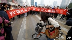 "A protest against a PX chemical plant in the city of Ningbo in Zhejiang province. The banner reads: ""Project PX get out of Ningbo, Ningbo people stand up."""