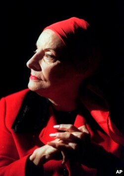 FILE - In this January 27, 1998, file photo, Alicia Alonso, founder of the Ballet Nacional de Cuba, listens during an interview in New York. (AP Photo/Bebeto Matthews, File)