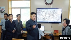 FILE - North Korean leader Kim Jong Un gives field guidance to the Hydro-meteorological Service.