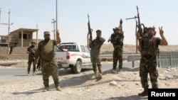 Fuerzas de seguridad iraquíes y voluntarios shiitas celebran el rompiendo del cerco del Estado Islámico en Amerli.