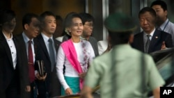 Myanmar's opposition leader Aung San Suu Kyi arrives at Beijing Capital International Airport in Beijing, China, June 10, 2015.