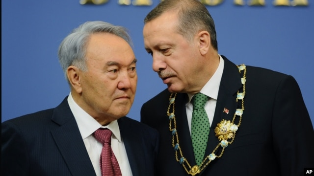 Turkey's Prime Minister Recep Tayyip Erdogan, right, and Kazakh President Nursultan Nazarbayev seen during a press conference in Ankara, October 11, 2012.