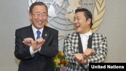 UN Secretary-General Ban Ki-moon, left, is taught how to dance 'Gangnam Style' by Korean rapper PSY during a photo opportunity at the UN headquarters in New York, October 23, 2012.