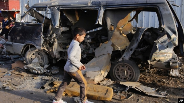 Site of a car bomb attack in Sadr City neighborhood in Baghdad, Iraq, Dec. 8, 2013.