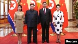 Кім Чен Ин і Сі Цзіньпін з дружинами у Пекіні