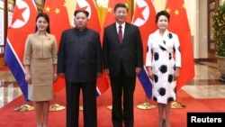 North Korean leader Kim Jong Un and wife Ri Sol Ju pose for a picture with Chinese President Xi Jinping and wife Peng Liyuan at the Great Hall of the People in Beijing, China in this picture released to Reuters on March 28, 2018. (Ju Peng/Xinhua via Reuters)