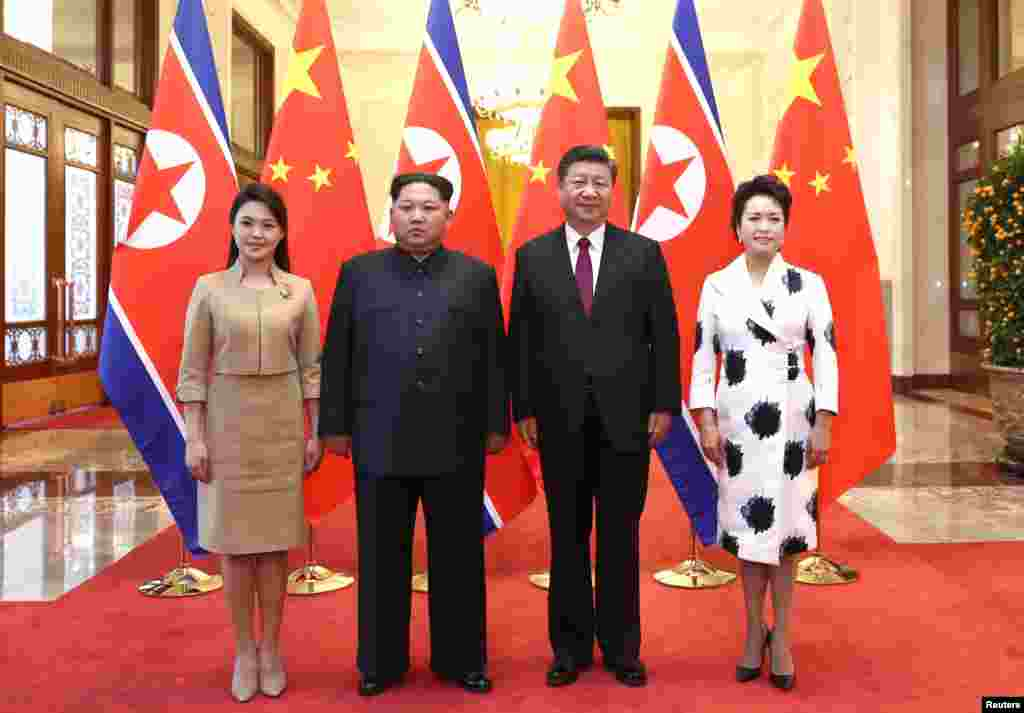 North Korean leader Kim Jong Un and his wife Ri Sol Ju pose for a picture with Chinese President Xi Jinping and wife Peng Liyuan at the Great Hall of the People in Beijing, China, March 28, 2018.