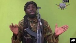 FILE - Image taken from video by Nigeria's Boko Haram in May 2014 shows leader Abubakar Shekau; a pledge of allegiance to Islamic State by the group has been attributed to him.