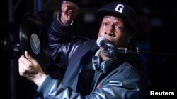 FILE - Hip-hop DJ Grandmaster Flash speaks at a ceremony where he is inducted into Guitar Center's RockWalk in Los Angeles, March 6, 2014.