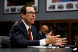 Treasury Secretary Steven Mnuchin testifies before a House Appropriations subcommittee, April 9, 2019, on Capitol Hill in Washington.