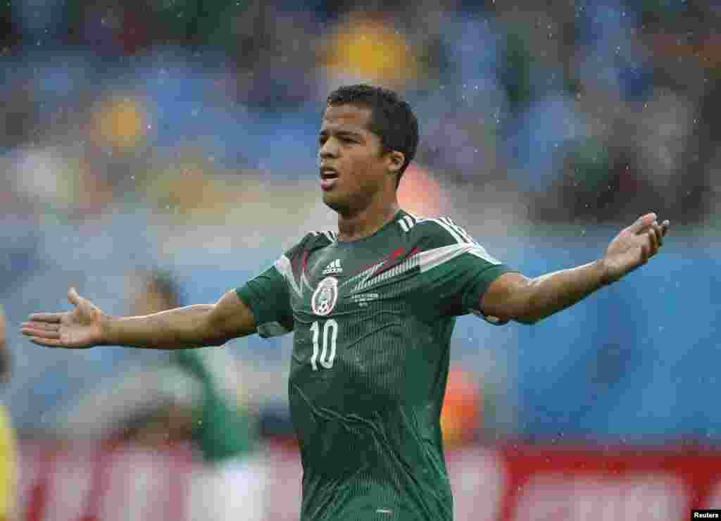 Mexico's Giovani Dos Santos gestures after he was caught offside during the 2014 World Cup Group A soccer match against Cameroon at the Dunas arena, Natal June 13, 2014.