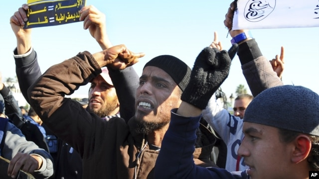 Muslim fundamentalists shout slogans during a protest in Tunis, Dec. 17, 2013 to mark the third anniversary of the Tunisian uprising.
