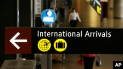 A sign for International Arrivals is shown at the Seattle-Tacoma International Airport, June 26, 2017, in Seattle, Washington.