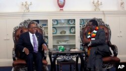 FILE: United States Ambassador to Zimbabwe Brian Nichols, left, is seen during a courtesy call with Zimbabwean President elect Emmerson Mnangagwa at his official residence State House in Harare, Wednesday, Aug, 15, 2018.