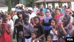 成百上千的難民和他們的支持者聚集在休斯頓,紀念世界難民日