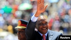 Kenya's President Uhuru Kenyatta arrives to attend Mashujaa (Heroes) Day at the Nyayo National Stadium in capital Nairobi, Oct. 20, 2013.
