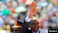 Kenyan President Uhuru Kenyatta arrives to attend Mashujaa Day at the Nyayo National Stadium, Nairobi, Oct. 20, 2013.