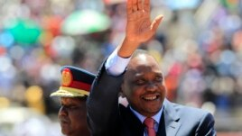 Kenya's President Uhuru Kenyatta arrives to attend Mashujaa (Heroes) Day at the Nyayo National Stadium in capital Nairobi, Oct. 20, 2013.