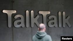 A man walks past a company logo outside a TalkTalk building in London, Oct. 23, 2015.