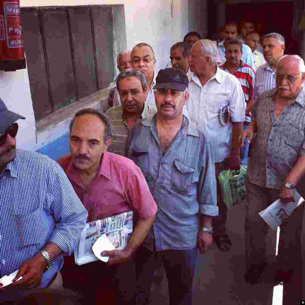 Egyptians line up to place their vote in their nation's presidential runoff in Cairo on June 16th, 2012.