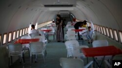 Palestinians visit a Boeing 707 after the plane was converted to a cafe restaurant, in Wadi Al-Badhan, near the West Bank city of Nablus, Wednesday, Aug. 11, 2021. (AP Photo/Majdi Mohammed)