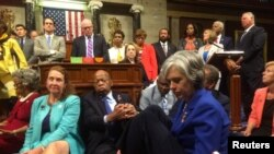 "A photo shot and tweeted from the floor of the U.S. House of Representatives by U.S. House Rep. Katherine Clark shows Democratic members of the House staging a sit-in on the House floor ""to demand action on common sense gun legislation"" on Capitol Hill in Washington, United States, June 22, 2016. U.S. Rep. Katherine Clark/Handout via Reuters."