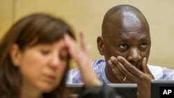 Congolese warlord Thomas Lubanga is seen at his appeals hearing at the International Criminal Court in The Hague Dec. 1, 2014.